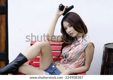 Sexy Asian Cowgirl - stock photo