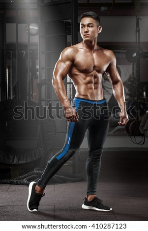 Sexy asian muscular man posing in gym, shaped abdominal. Strong male naked torso abs, working out - stock photo