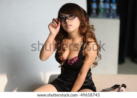 sexy asian woman bikini bed - stock photo