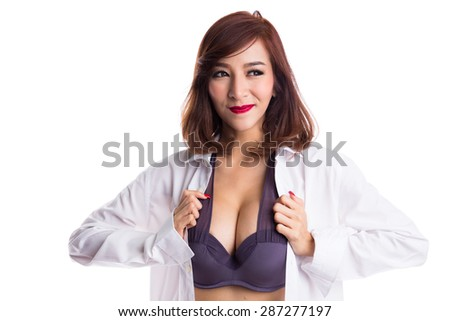 Sexy asian woman showing her sexy breast in purple bra or underwear with shirt opened by hand, looking away, isolated on white background - stock photo