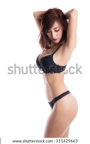 Sexy asian woman wearing black lingerie posing, isolated on white background - stock photo