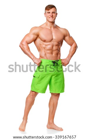 Sexy athletic man showing muscular body, isolated over white background. Strong male nacked torso abs - stock photo