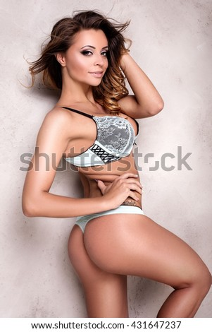 Sexy attractive brunette woman posing in fashionable lingerie, studio shot. Perfect slim body.  - stock photo