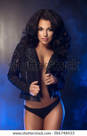 Sexy attractive brunette woman posing in studio  - stock photo