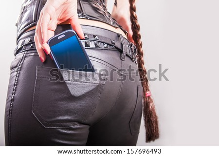 sexy back. cell phone in back pocket - stock photo