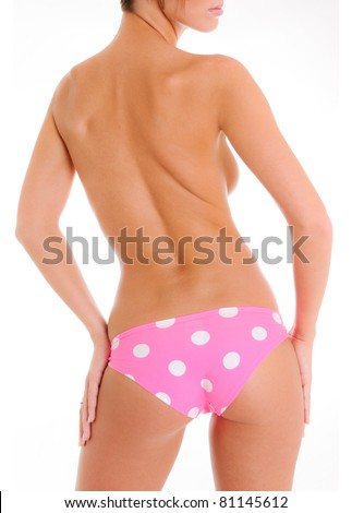 Sexy Backside of a Woman Wearing Pink Polka Dot Panties - stock photo