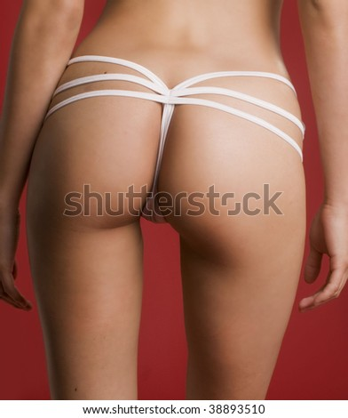 Sexy backside of well toned glamor model - stock photo