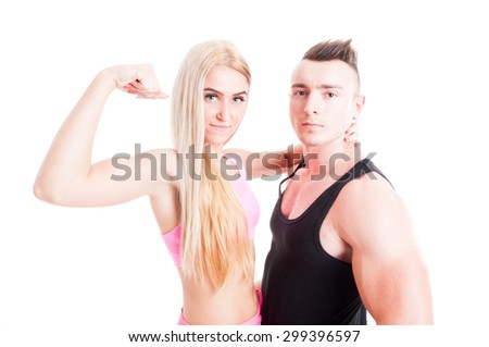Sexy beautiful and young fitness couple with active and healthy life posing on white studio background - stock photo