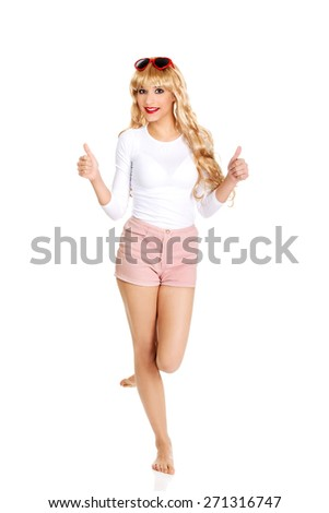 Sexy beautiful blonde woman in sunglasses with thumbs up. - stock photo