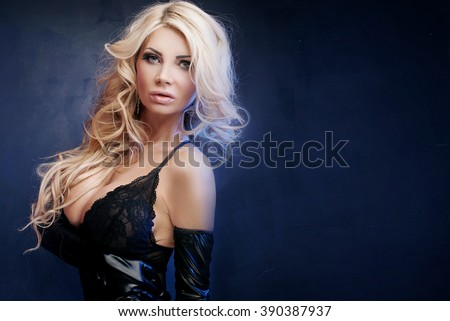 Sexy beautiful blonde woman posing in elegant black lingerie, looking at camera. Perfect body.  - stock photo