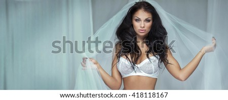 Sexy beautiful bride woman posing in white lingerie.  - stock photo