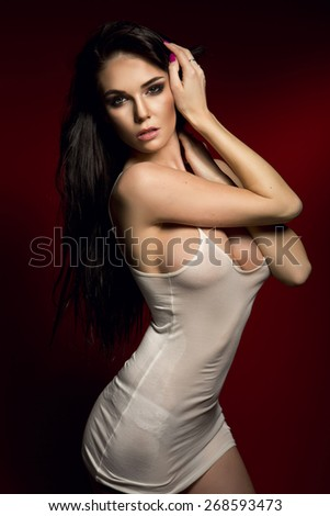 Sexy beautiful brunette woman with perfect body posing naked. Girl with long healthy hair. - stock photo
