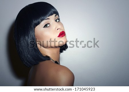 Sexy Beautiful Brunette young Woman. Retro Haircut. Healthy Black Hair. Red Lips. Beauty Girl. Accessories  - stock photo