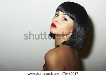 Sexy Beautiful Brunette young Woman. Retro style. Healthy Black Hair. bob Haircut. red lips. beauty Girl - stock photo