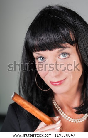 sexy beautiful business woman smoking cigar closeup - stock photo