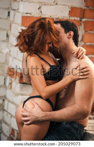Sexy beautiful couple kissing outdoors - stock photo