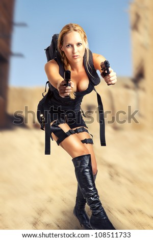 Sexy beautiful dangerous woman holding two hand gun - stock photo