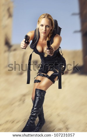 Sexy beautiful dangerous woman shooting from two hand guns - stock photo