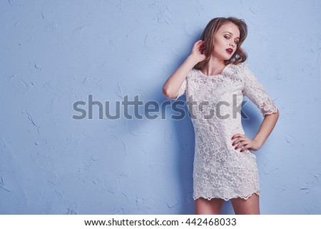 Sexy beautiful woman wearing white dress bride long curly hair isolated on white - stock photo