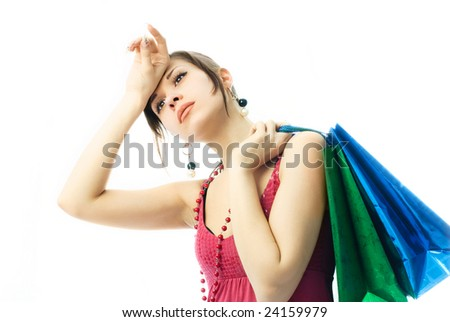 sexy beautiful young brunette woman with paper bags tired of shopping - stock photo