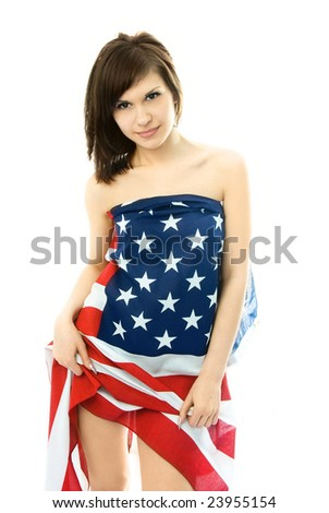 sexy beautiful young nude woman wrapped into an American flag - stock photo