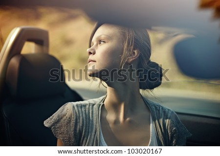 sexy beautiful young woman driving her convertible car - stock photo