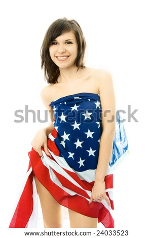 sexy beautiful young woman wrapped into the American flag - stock photo