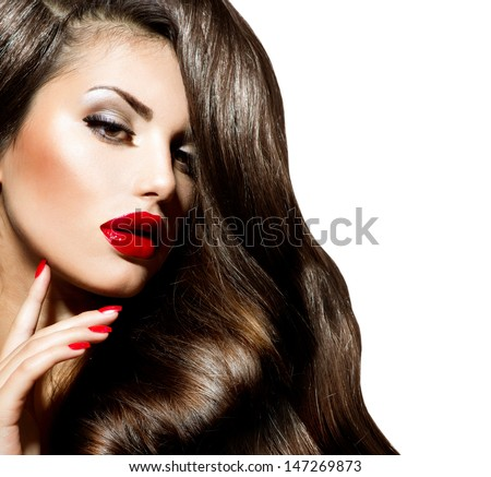 Sexy Beauty Girl with Red Lips and Nails. Make up. Luxury Woman with Long Curly Hair. Fashion Brunette Portrait isolated on a white background. Gorgeous Woman Face.  - stock photo