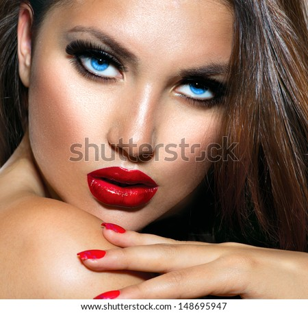 Sexy Beauty Girl with Red Lips and Nails. Provocative Make up. Luxury Woman with Blue Eyes. Fashion Brunette Portrait. Gorgeous Woman Face. Long Hair - stock photo
