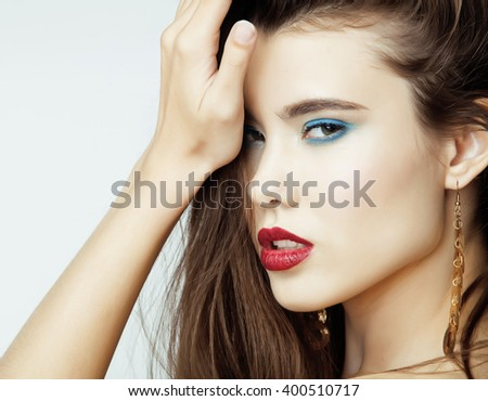 Sexy Beauty Girl with Red Lips and Nails. Provocative Make up. Luxury Woman with Blue Eyes. Fashion Brunette Portrait isolated on a white background. Gorgeous Woman Face. Long Hair closeup - stock photo