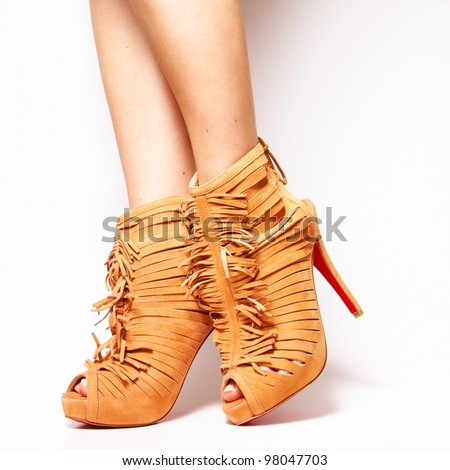 Sexy beauty long woman legs wearing fashion high heel shoes isolated on white studio background - stock photo