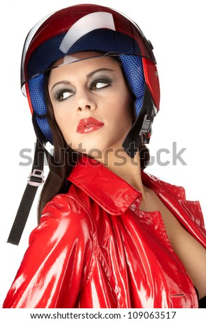 Sexy biker. woman with red helmet - stock photo