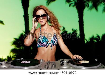 sexy bikini dj in a beach party - stock photo
