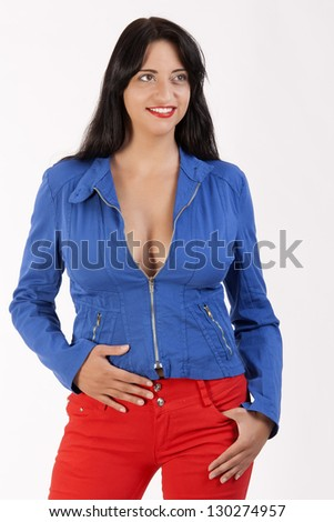Sexy black-haired woman with blue jacket and red pants / Color around the world - stock photo