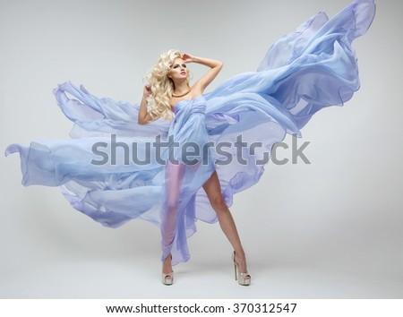 Sexy blond beauty woman in blue dress  - stock photo