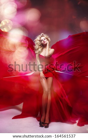 Sexy blond beauty woman in red dress - stock photo