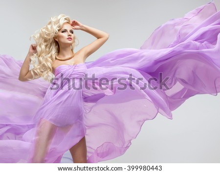Sexy blond beauty woman in violet dress - stock photo
