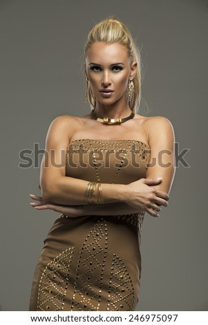 Sexy blond lady in dress on dark background  - stock photo