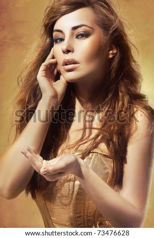 Sexy blond lady showing your object, empty hand with copy-space - stock photo