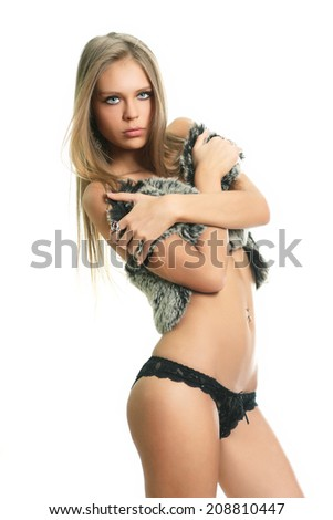 Sexy blond woman in black lingerie  - stock photo