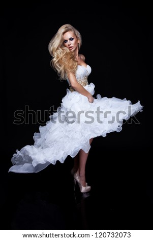 Sexy blond woman in white dress - stock photo