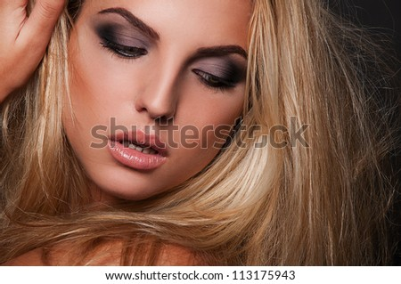 sexy blond woman on black background - stock photo