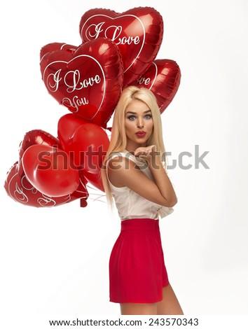 Sexy blond woman send kiss - stock photo