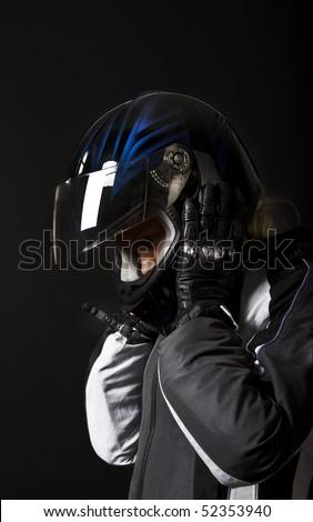Sexy  blonde biker wearing her black helmet - stock photo