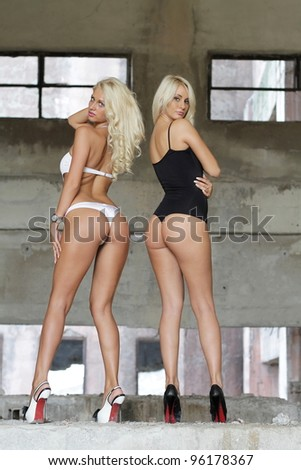 Sexy blonde posing in empty factory - stock photo