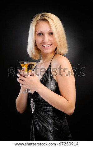 Sexy blonde standing with goblet in both hands - stock photo