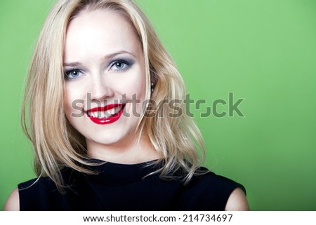 Sexy blonde woman on green background - stock photo