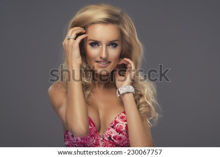 Sexy blonde woman posing in fashionable swimsuit posing  - stock photo