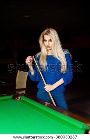 Sexy blonde woman rubbed cue chalk. Billiard sport concept. Pool billiard game. American pool billiard. - stock photo