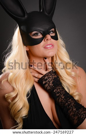 Sexy Blonde Woman wearing black bunny ears - stock photo